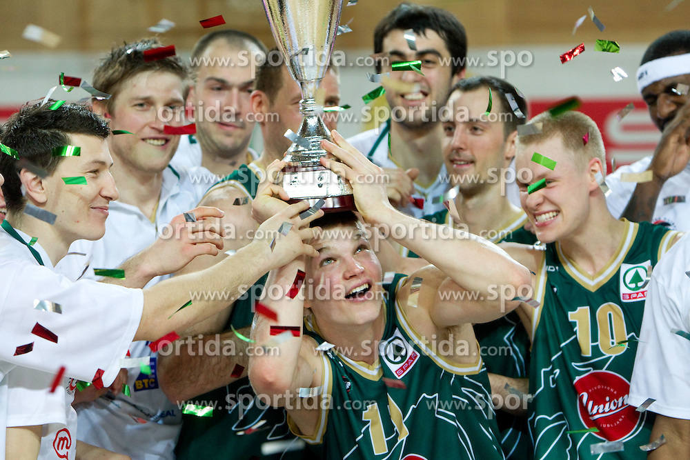Dino Muric and other players of Union Olimpija celebrate after winning the basketball match between KK Helios Domzale and KK Union Olimpija in Final of Spar Slovenian Cup, on February 13, 2011 in Sportna dvorana Poden, Skofja Loka, Slovenia. Union Olimpija defeated Helios 92-55 and become Slovenian Cup Champion. (Photo By Vid Ponikvar / Sportida.com)