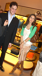 LORD FREDERICK WINDSOR and MISS DASHA ZHUKOVA at a party to celebrate the 2nd anniversary of Quintessentially magazine held at Asprey, Bond Street, London on 24th February 2005.<br /><br />NON EXCLUSIVE - WORLD RIGHTS