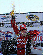 HAMPTON, GA: Carl Edwards celebrates in victory lane   after winning the Pep Boys Auto 500 at Atlanta Motor Speedway on Sunday10/26/08, © 2008 Johnny Crawford
