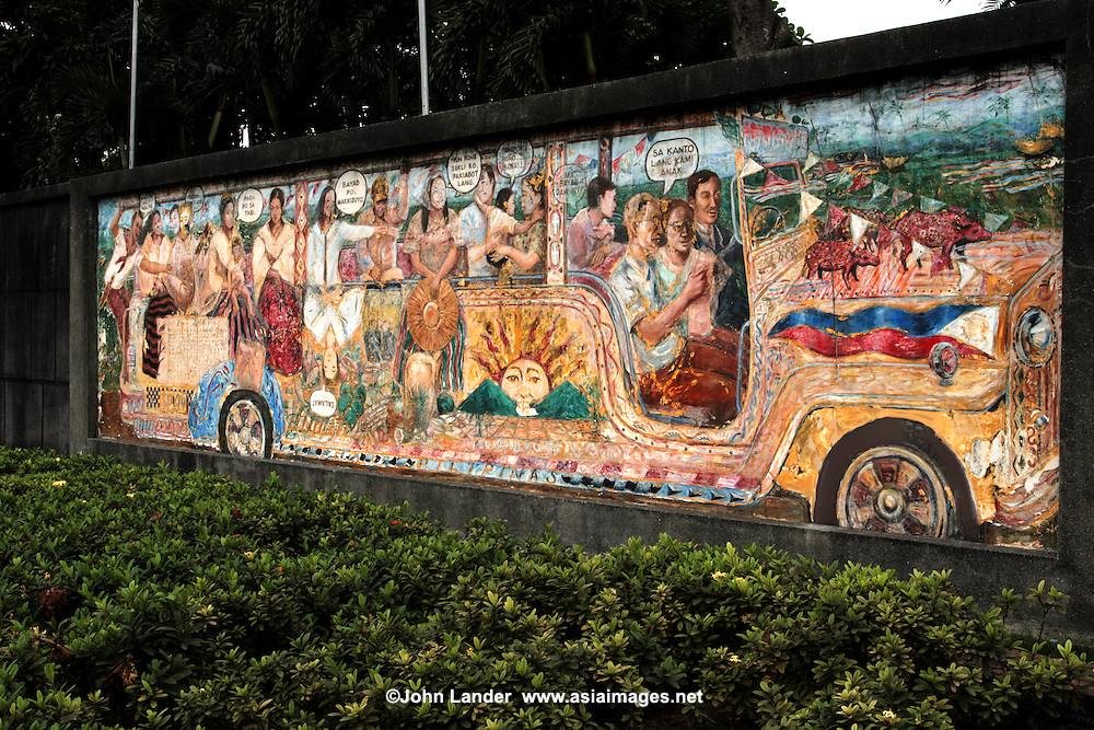 Rizal Park Mural, Manila - Rizal Park's history began in the early 1700s during Spanish rule. While Manila's social and business activities were confined within Intramuros, a small area just south of the walls was cleared to prevent sneak attacks from the patriotic natives. The area was shaped like a small moon and thus was named Luneta. The park in modern times has become a local spot for families to have picnics on Sundays and holidays and a major tourist attraction of Manila. It has a small man-made lake with a replica of the Philippine archipelago in the middle. Other attractions of Rizal Park include the Chinese and Japanese Gardens, the National Museum of the Filipino People, the Orchidarium,  a children's lagoon, a chess plaza, and  a bas-relief map of the Philippine islands.