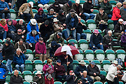 Umbrellas start going up as rain stops play during the opening day of the Specsavers County Champ Div 1 match between Somerset County Cricket Club and Hampshire County Cricket Club at the Cooper Associates County Ground, Taunton, United Kingdom on 11 May 2018. Picture by Graham Hunt.
