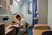 A prisoner in an induction cell on E wing. HMP Wandsworth, London, United Kingdom