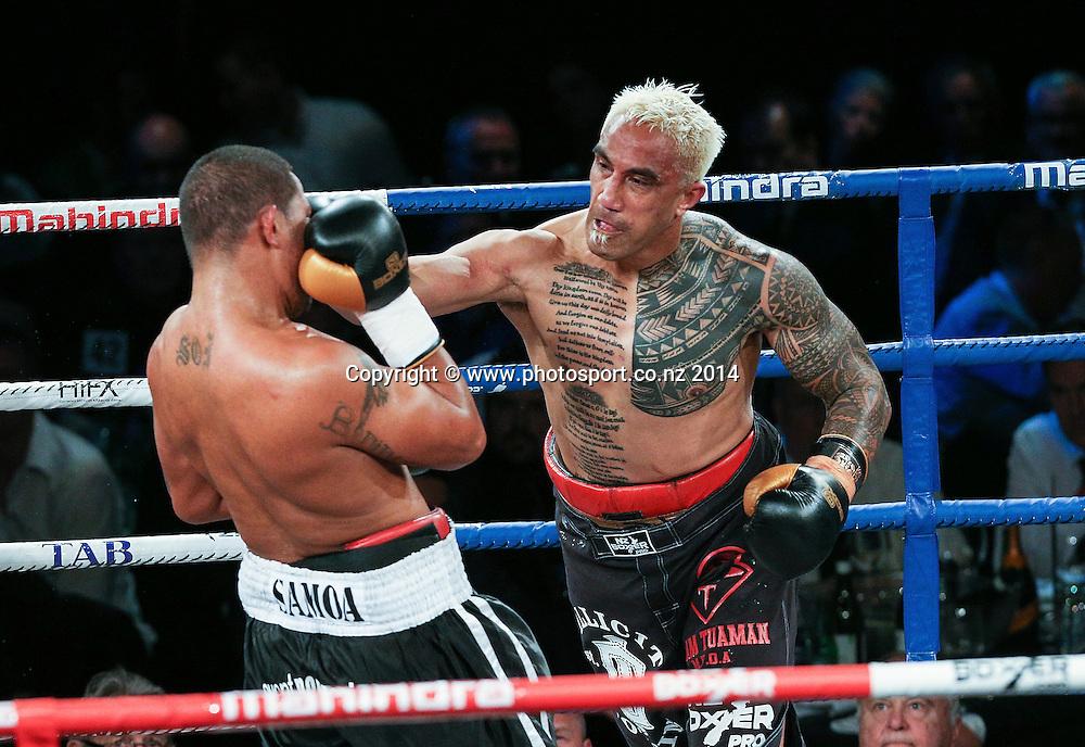 Vaitele SoI (L) fights Monty Filimaea in the Mahindra Super 8 Fight Night, North Shore Events Centre, Auckland, New Zealand, Saturday, November 22, 2014. Photo: David Rowland/Photosport