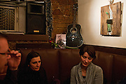 Friends and colleagues of the late writer Emir Sakovic at the writer's bar Underground in Sarajevo following a memorial poetry reading.