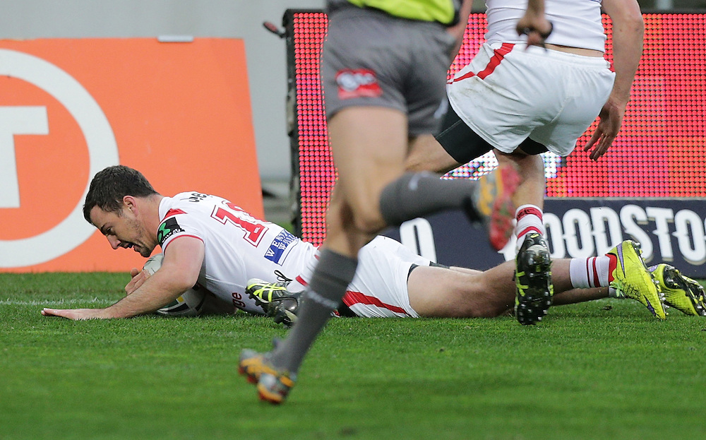 Justin Hunt of the Dragons scores a try agaianst the Warriors during their round 22 NRL match at Westpac  Stadium, Wellington on  Saturday, August 08, 2015. Credit: SNPA / David Rowland