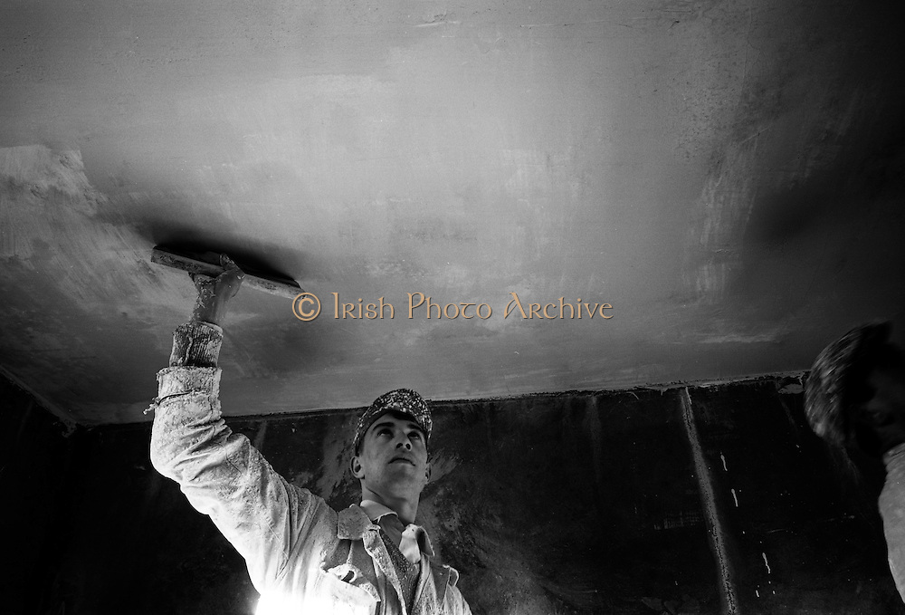 Painting at the Ballymun Housing Scheme. The Ballymun tower blocks were seven landmark residential towers built to accommodate the rising population, and particularly to accommodate former residents of inner-city areas which were being cleared in the process of 1960s 'urban slum clearances'. .03.01.1968