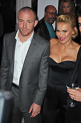 DIANA JENKINS and GUY RITCHIE at the launch of Project PEP to benefit the Elton John Aids Foundation hosted by Tamara Mellon and Diana Jenkins in association with Jimmy Choo held at Selfridges, Oxford Street, London on 29th October 2009.