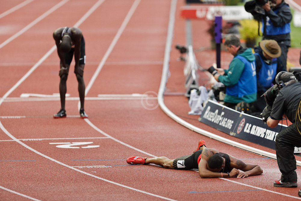 men's 800 meter final homestretch, Duane Solomon lies on track after finish