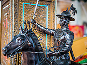 05 JANUARY 2015 - THONBURI, BANGKOK, THAILAND:  A statue of King Taksin the Great at Wat Intharam, an Ayutthaya period temple in the Thonburi section of Bangkok. Wat Intharam was reportedly the favorite temple of King Taksin the Great, the Thai King credited with reunifying Siam (Thailand) after the Burmese sacked the ancient capital of Ayutthaya in 1767 CE. Taksin established the new Thai capital city in Thonburi, which is closer to the ocean and more easily defended, and made Wat Intharam his personal favorite. He was cremated at Wat Intharam following his death in 1782. His ashes are at the temple. There is a memorial to King Taksin the Great at the back of the temple grounds.    PHOTO BY JACK KURTZ