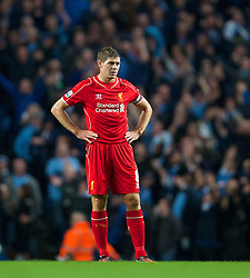 MANCHESTER, ENGLAND - Monday, August 25, 2014: Liverpool's captain Steven Gerrard looks dejected as Manchester City score the opening goal during the Premier League match at the City of Manchester Stadium. (Pic by David Rawcliffe/Propaganda)