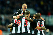 Miguel Almiron (#24) of Newcastle United leaps on top of his Newcastle United teammates in celebration of Ciaran Clark (#2) of Newcastle United scoring Newcastle United's second goal (2-1) during the Premier League match between Newcastle United and Bournemouth at St. James's Park, Newcastle, England on 9 November 2019.