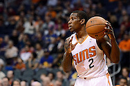 Dec 15, 2013; Phoenix, AZ, USA; Phoenix Suns guard Eric Bledsoe (2) handles the ball against the Golden State Warriors in the first half at US Airways Center. Mandatory Credit: Jennifer Stewart-USA TODAY Sports