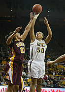 February 18, 2010: Iowa forward Gabby Machado (50) shoots over Minnesota forward/center Ashley Ellis-Milan (21) during the second half of the NCAA women's basketball game at Carver-Hawkeye Arena in Iowa City, Iowa on February 18, 2010. Iowa defeated Minnesota 75-54.