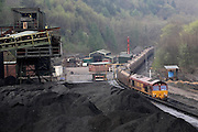 A cargo train transporting coal from Unity Mine to the biggest power station in Wales, Aberthaw, run by the energy giant nPower, is arriving at the Unity complex to loaded, on Friday, Apr. 13, 2007, in Cwmgwrach, Vale of Neath, South Wales. The time is ripe again for an unexpected revival of the coal industry in the Vale of Neath due to the increasing prize and diminishing reserves of oil and gas, the uncertainties of renewable energy sources, and the technological advancement in producing energy from coal while limiting emissions of pollutants, has created the basis for valuable investment opportunities and a possible alternative to the latest energy crisis. Unity Mine, in particular, has started a pioneering effort to revive the coal industry in the area, reopening after more than 8 years with the intent of exploiting the large resources still buried underground. Coal could be then answer to both, access to cheaper and paradoxically greener energy and a better and safer choice than nuclear energy as a major supply for the decades to come. It is estimated that coal reserves in Wales amount to over 250 million tonnes, or the equivalent of at least 50 years of energy supply, while the worldwide total coal could last for over 200 years as a viable resource compared to only a few decades of oil and natural gas.