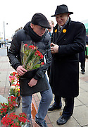© Licensed to London News Pictures. 21/02/2013. Eastleigh, UK. Business Secretary and Liberal Democrat Vince Cable buys a bunch of roses from a flower seller whilst campaigning for the  Eastleigh by-election today 21 February 2013. Photo credit : Stephen Simpson/LNP