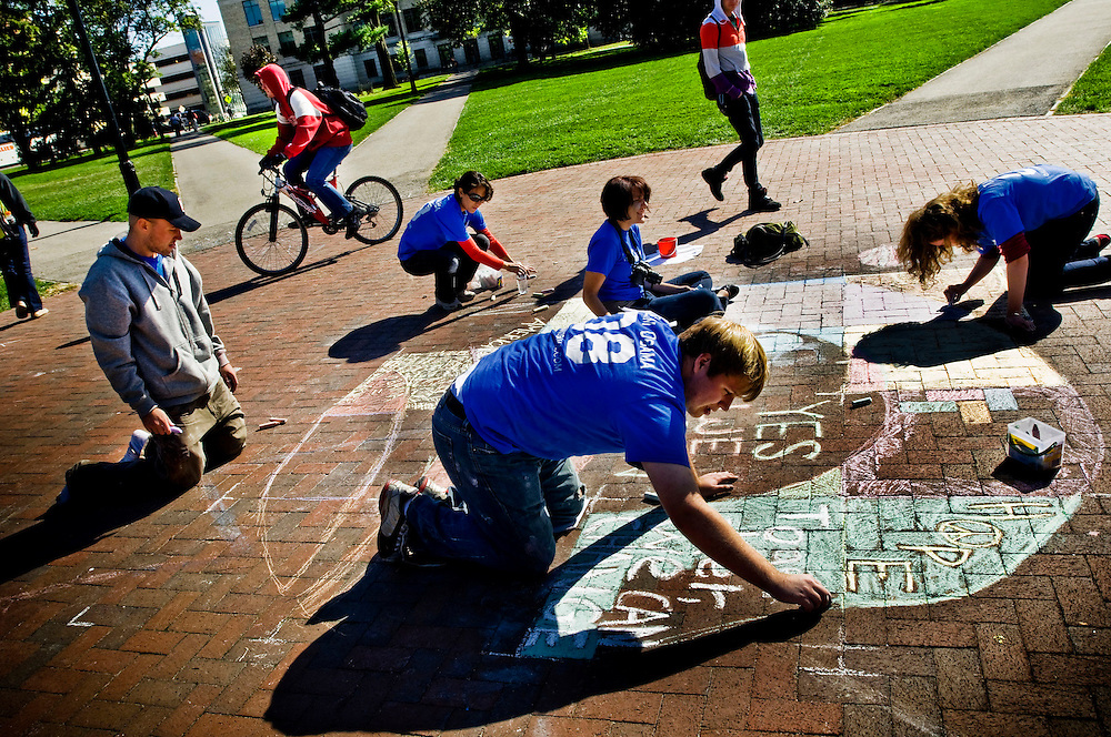 Ohio Swingstate..Students and Obama volunteers making chalk drawings of pro-Obama messages at the Ohio State University Campus in Columbus..Matt Caffrey in foreground..Photographer: Chris Maluszynski /MOMENT