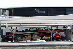 © Licensed to London News Pictures. 04/11/2014. A range of smaller motorboats and jetskis are stored inside the superyacht Kismet. The beautiful superyacht Kismet glistens in the autumn sunshine in London today. The vessel is widely reported to be owned by Shahid Khan,  the owner of Premier League football club, Fulham FC. He also owns the NFL team the Jacksonville Jaguars and today a brand new, opulent silver Jaguar mascott was attached to the bow of the superyacht along with a silver NFL helmet. Khan is reported to have a Khan's net worth over $4.6. billion Credit : Rob Powell/LNP