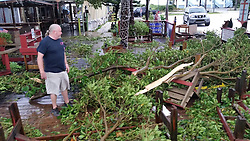 October 7, 2016 - Florida, U.S. - Ryan Stasa checks out damage at Archie's Seabreeze in Fort Pierce, Hutchinson Island, after hurricane Matthew passed through. 10/7/2016. (Credit Image: © Zachary Sampson/Tampa Bay Times via ZUMA Wire)