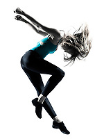 Side view of blond haired woman doing gymnastic jump in studio on white background