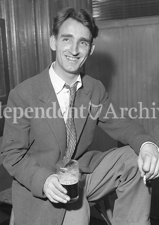 Portrait of a man with a pint in a pub. (Part of the Independent Ireland Newspapers/NLI Collection)