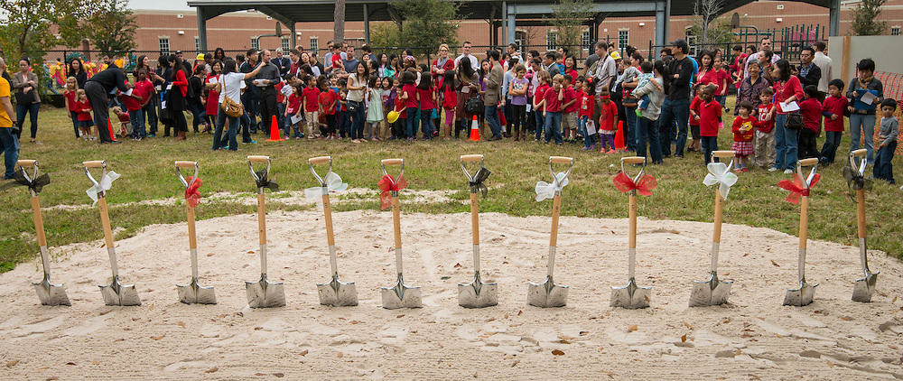 Attendees gather during a groundbreaking ceremony for the new Mandarin Chinese Language Immersion Magnet School, December 6, 2014.