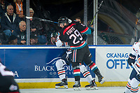KELOWNA, CANADA - SEPTEMBER 22: Nolan Foote #29 of the Kelowna Rockets checks a player of the Kamloops Blazers into the boards on September 22, 2018 at Prospera Place in Kelowna, British Columbia, Canada.  (Photo by Marissa Baecker/Shoot the Breeze)  *** Local Caption ***