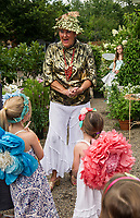 "The ""Golden"" Fairy welcomes Morgan and Hailey Brooks to Fairy Night at Cackleberries Garden Center in Meredith Wednesday evening.  (Karen Bobotas/for the Laconia Daily Sun)"