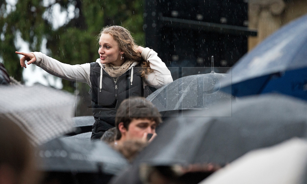 © London News Pictures. 01/05/2012. Oxford, UK. A woman enjoying the May Day celebrations on Magdalen Bridge, Oxford on May 1, 2012. Revelers where prevented from jumping from the bridge, which is tradition on May Day, due to safety risks. Photo credit : LNP