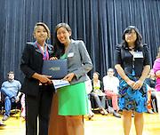 Karen Ortiz receives her Passport Award.