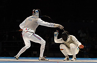 Brice Guyart (France,left) versus Salvatore Sanzo (Italy) in the Mens Foil Gold Medal Match. Fencing, Athens Olympics, 16/08/2004. Credit: Colorsport / Matthew Impey DIGITAL FILE ONLY