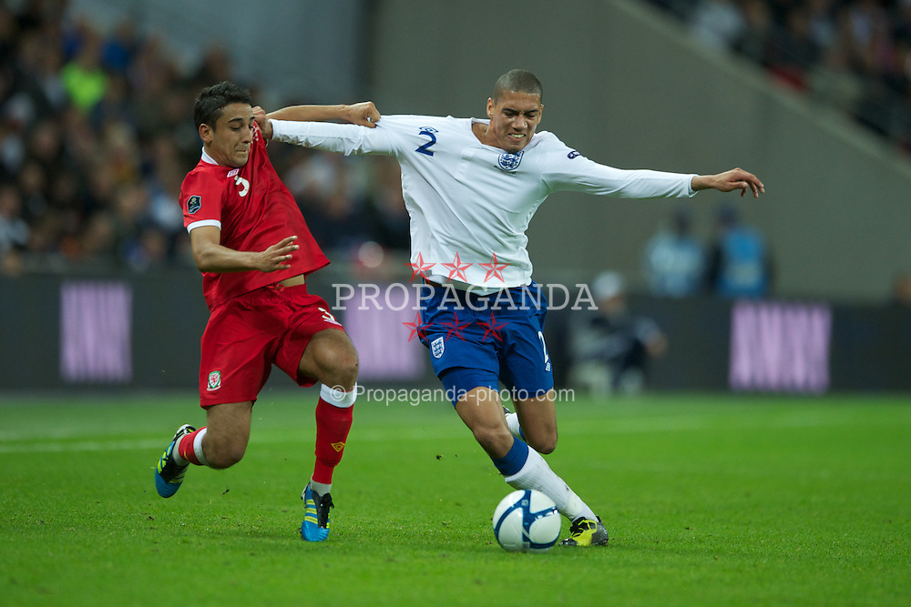 LONDON, ENGLAND - Tuesday, September 6, 2011: Wales' Neil Taylor in action against England's Chris Smalling during the UEFA Euro 2012 Qualifying Group G match at Wembley Stadium. (Pic by Chris Brunskill/Propaganda)