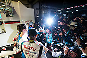 June 13-18, 2017. 24 hours of Le Mans. 7 Toyota Racing, Toyota TS050 Hybrid, Mike Conway, Kamui Kobayashi, Stephane Sarrazin photographers crowd the garage after Toyota takes pole