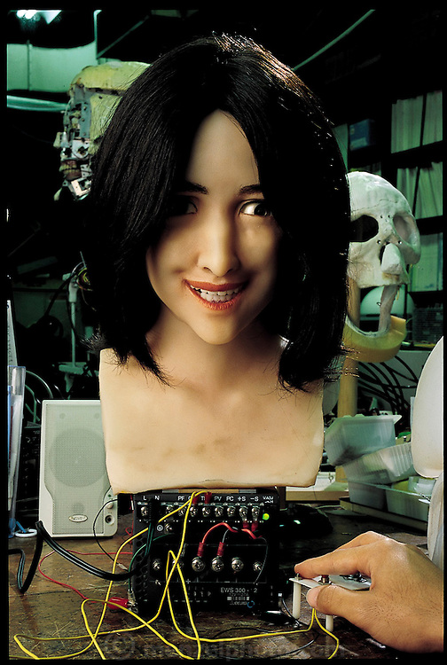 "A work in progress, this still-unnamed face robot can open its eyes and smile. In the future, says its designer, Hidetoshi Akasawa, a mechanical engineering student working on a master's at the Science University of Tokyo, Japan,  it will be able to recognize and react to human facial expressions. This third-generation robot will greet smiles with smiles, frowns with frowns, mixing and matching six basic emotions in a real-time interaction that Hara calls ""active human interface."" From the book Robo sapiens: Evolution of a New Species, page 72."
