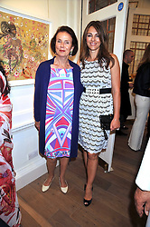 GUNNAR NAYAR and her daughter in law LIZ HURLEY  at a party to launch the Indian Head Injury Foundation held at Thomas Gibson Fine Art Ltd. 31 Bruton Street, London on 16th June 2009