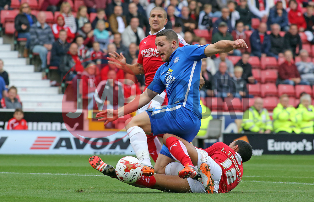 Conor Washington of Peterborough United is tackled by Louis Thompson of Swindon Town - Mandatory byline: Joe Dent/JMP - 07966 386802 - 10/10/2015 - FOOTBALL - County Ground - Swindon, England - Swindon Town v Peterborough United - Sky Bet League One