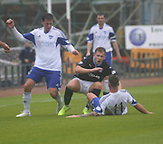Dundee's Greg Stewart takes a sore one form Peterhead's Ryan Strachan- Dundee v Peterhead, League Cup at Dens Park<br /> <br />  - &copy; David Young - www.davidyoungphoto.co.uk - email: davidyoungphoto@gmail.com