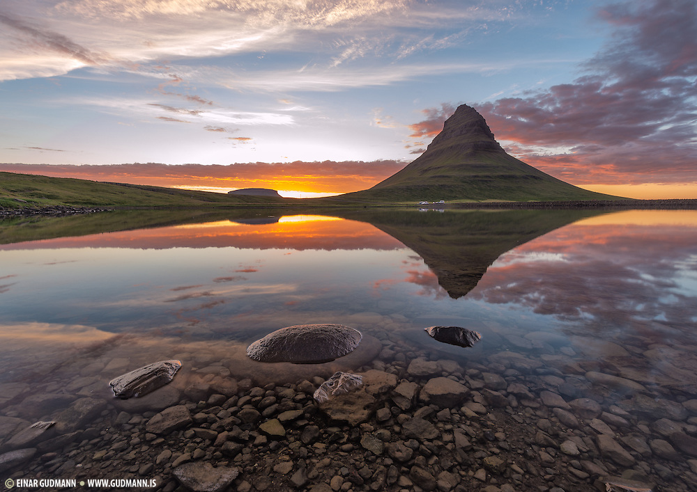 The Kirkjufell mountain in late sunset. Polarizer shows the rocks at the bottom of the lake.