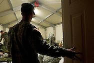 Apr, 8, 2011, Camp Edwards, Massachusetts - Cadet Jon Broderick enters a tent at the tactical training base looking for members of his training Squadron. Squads are made up of cadets from various schools and they meet for the first time the night before field training begins. Photo by ©Lathan Goumas.