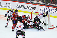 2019-11-16 | Örebro, Sweden:  A lot of players in the goal during the game between Örebro HK and Malmö Redhawks at Behrn Arena ( Photo by: Hasse Persson | Swe Press Photo )<br /> <br /> Keywords: Behrn Arena, Örebro, Ice hockey, SHL, Örebro HK, Malmö Redhawks, hpöm191116