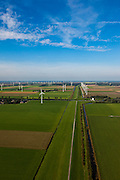 Nederland, Oostelijk Flevoland, Gemeente Zeewolde, 03-10-2010; Knardijk richting Knarbos (noordwestelijke richting), omgeven door windmolens en windmolenparken. De dijk vormt de grens tussen Oostelijk en Zuidelijk Flevoland en voorkomt dat bij een dijkdoorbraak de gehele Flevopolder overstroomt..Knar dijk in the direction of the 'Knar woods'. The dike forms the border between Eastern and Southern Flevoland and prevents in case of breach of the outer dikes of the polder, that the entire Flevo polder will be flooded.luchtfoto (toeslag), aerial photo (additional fee required).foto/photo Siebe Swart