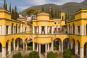 La Prioria, home of Gabriele D'Annunzio, 1863-1938, Italian writer, soldier and fascist, at Vittoriale degli italiani, or The Shrine of Italian Victories, his estate and museums at Gardone Riviera, Lake Garda, Brescia, Lombardy, Italy. The house was originally the Villa Cargnacco, which was rebuilt by Gian Carlo Maroni from 1922 and developed until 1955. The estate consists of the Prioria, where d'Annunzio lived 1922-38, an amphitheatre, the protected cruiser Puglia, the MAS vessel used by D'Annunzio in 1918 and a mausoleum. It is part of the Grandi Giardini Italiani. Picture by Manuel Cohen