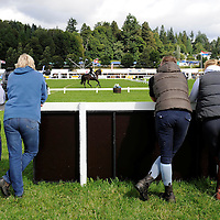 Blair Castle Horse Trials 2012 Photo Essay at Blair Castle, Blair Atholl, Perthshire. Spectators watch a rider doing their dressage test in the main arena.  Picture Christian Cooksey.