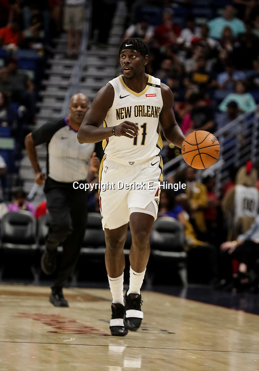 Oct 11, 2018; New Orleans, LA, USA; New Orleans Pelicans guard Jrue Holiday (11) against the Toronto Raptors during the first half at the Smoothie King Center. Mandatory Credit: Derick E. Hingle-USA TODAY Sports