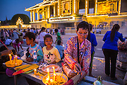 "30 JANUARY 2013 - PHNOM PENH, CAMBODIA: Cambodians light incense and candles for late Cambodian King Norodom Sihanouk in Phnom Penh. Sihanouk (31 October 1922 - 15 October 2012) was the King of Cambodia from 1941 to 1955 and again from 1993 to 2004. He was the effective ruler of Cambodia from 1953 to 1970. After his second abdication in 2004, he was given the honorific of ""The King-Father of Cambodia."" Sihanouk held so many positions since 1941 that the Guinness Book of World Records identifies him as the politician who has served the world's greatest variety of political offices. These included two terms as king, two as sovereign prince, one as president, two as prime minister, as well as numerous positions as leader of various governments-in-exile. He served as puppet head of state for the Khmer Rouge government in 1975-1976. Most of these positions were only honorific, including the last position as constitutional king of Cambodia. Sihanouk's actual period of effective rule over Cambodia was from 9 November 1953, when Cambodia gained its independence from France, until 18 March 1970, when General Lon Nol and the National Assembly deposed him. Upon his final abdication, the Cambodian throne council appointed Norodom Sihamoni, one of Sihanouk's sons, as the new king. Sihanouk died in Beijing, China, where he was receiving medical care, on Oct. 15, 2012. His cremation is scheduled to take place on Feb. 4, 2013. Over a million people are expected to attend the service.        PHOTO BY JACK KURTZ"