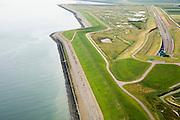 Nederland, Zeeland, Zuid-Beveland,, 04-07-2006; luchtfoto : Noordelijke ingang Westerscheldetunnel, direkt ten Westen van het dorpje Ellewoutsdijk, links de Westerschelde, in het midden de zeedijk; aan weerszijden van de toegangsweg is nog een dijk, maar deze heeft een geluidswerende functie en zorgt ook voor de inpassing in het omringende landschap; landschapsarchitectuur, planologie, verkeer en vervoer, tol, privaat publieke samenwerking, PPS, mobiliteit, auto, infrastructuur, milieu; zie ook andere (lucht)foto's van deze lokatie, deevan de serie Panorama Nederland.luchtfoto (toeslag); aerial photo (additional fee required); .foto Siebe Swart / photo Siebe Swart