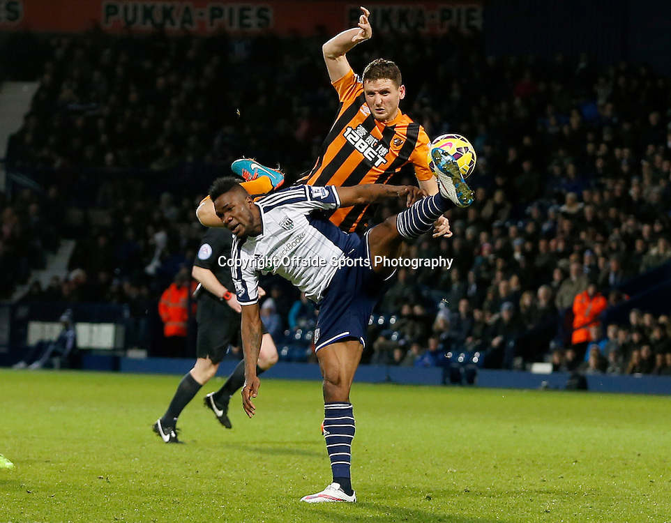 10th January 2015 - Barclays Premier League - West Bromwich Albion v Hull City - Brown Ideye of West Bromwich Albion and Alex Bruce of Hull City leaps to control a high ball - Photo: Paul Roberts / Offside.