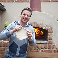 London, UK - 20 May 2013: Jamie Oliver cooks pizza at the Gaze Burvill stand during the RHS Chelsea Flower Show 2013 edition press day.