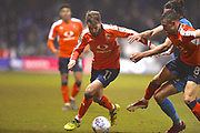 Luton Town player Andrew Shinnie fights for the ball in the second half during the EFL Sky Bet League 2 match between Luton Town and Barnet at Kenilworth Road, Luton, England on 24 March 2018. Picture by Ian  Muir.