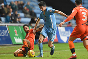 Wycombe Wanderers striker Nathan Tyson (23) battles with Coventry City midfielder Peter Vincenti (7) 2-0 during the EFL Sky Bet League 2 match between Coventry City and Wycombe Wanderers at the Ricoh Arena, Coventry, England on 22 December 2017. Photo by Alan Franklin.