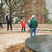 Monacan Chief, Dean Branham, left takes a picture of his cousin, Branch Branham, at the new monument, Mantle: Virginia Indian Tribute, built on the Virginia State Capitol Square, in Richmond, Virginia, on Tuesday, April 17, 2018. John Boal Photography